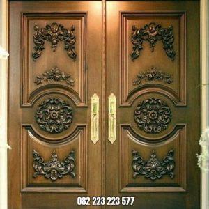 Pintu Rumah Ukir Kupu Tarung Kayu Jati