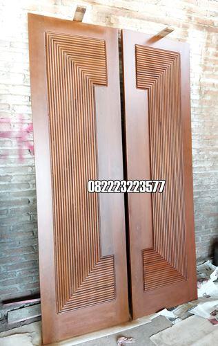 Model Pintu Jati Motif Kupu Tarung Minimalis